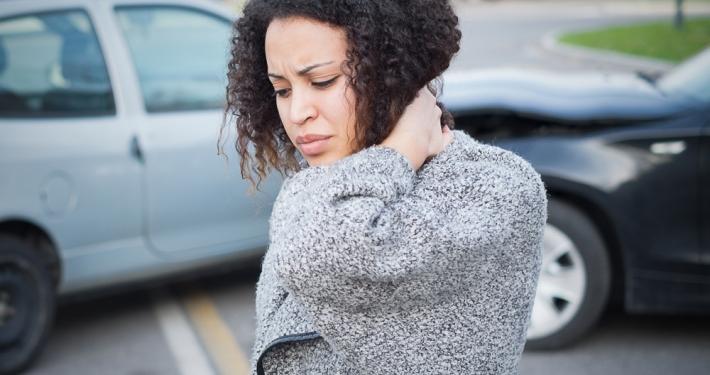 sore woman after car crash